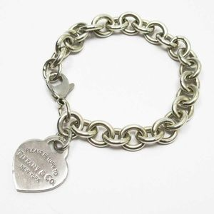 Auth Tiffany & Co heart tag bracelet